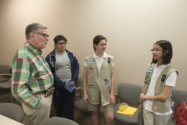 Michael Luckman of SCORE, left, speaks with Isabella Ho, right, and Ashley de la Garza, second from right, about the Girl Scouts of Southern Nevada CEO in Training program at the Urban Chamber of  ...