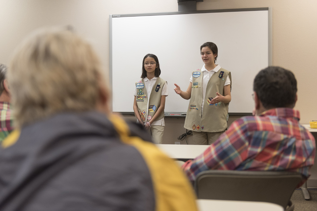 Isabella Ho, left, and Ashley de la Garza give a presentation to members of SCORE about the business of Girl Scout Cookies as part of the Girl Scouts CEO in Training program at the Urban Chamber o ...