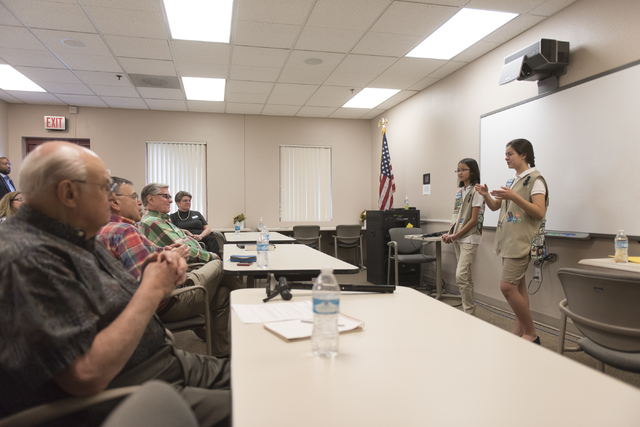 Isabella Ho, left, and Ashley de la Garza give a presentation to members of SCORE about the business of Girl Scout Cookies and the Girl Scouts CEO in Training program at the Urban Chamber of Comme ...