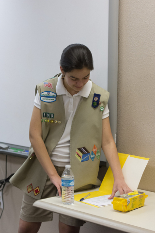 Ashley de la Garza grabs a Girl Scout Cookies order form during a presentation to members of SCORE about the business of Girl Scout Cookies and the Girl Scouts CEO in Training program at the Urban ...