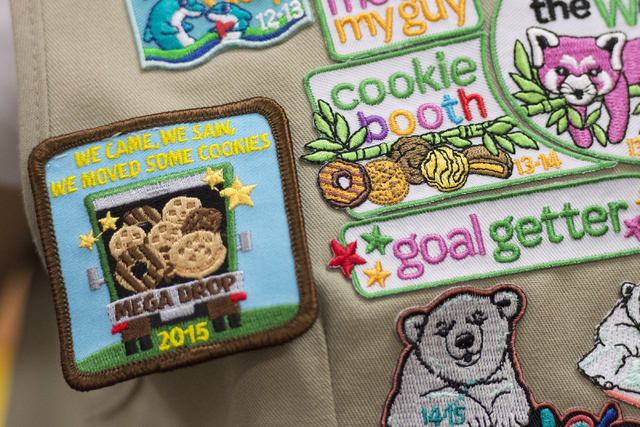 Ashley de la Garza's badges related to Girl Scout Cookies are seen on her vest following a presentation about the business of Girl Scout Cookies and the Girl Scouts CEO in Training program at the  ...