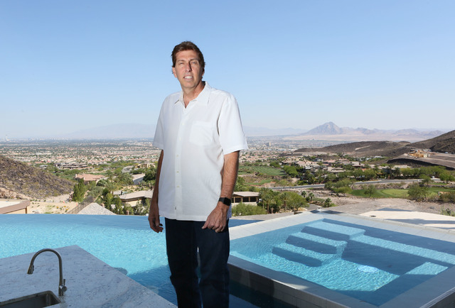 Daniel Coletti, president of Sun West Custom Homes, stands near a sunken bar located inside an infinity pool overlooking the valley at an under-construction luxury home Tuesday, June 2, 2015, in H ...