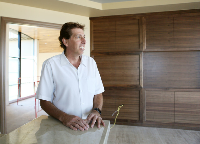Daniel Coletti, president of Sun West Custom Homes, stands in a second master suite in an under-construction luxury home Tuesday, June 2, 2015, in Henderson. The 12,000-square-foot custom-built ho ...