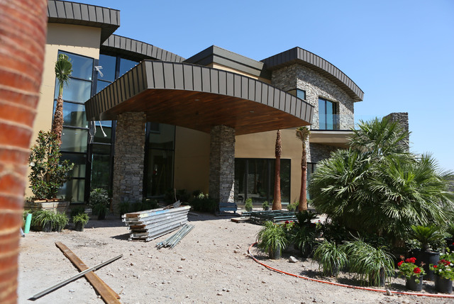 Construction takes place on a 12,000 sq.-ft. custom-built and luxury home located in MacDonald Highlands exclusive gated golf course community Tuesday, June 2, 2015, in Henderson. (Ronda Churchill ...