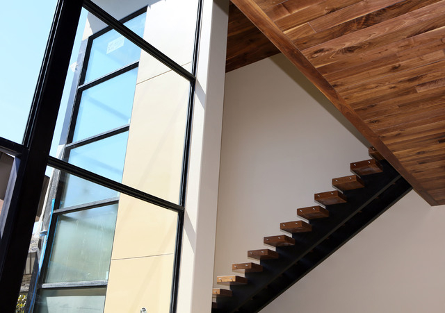 A walnut slab staircase and walnut ceiling details are shown in a 12,000 square-foot custom-built luxury home located in MacDonald Highlands exclusive gated golf course community Tuesday, June 2,  ...