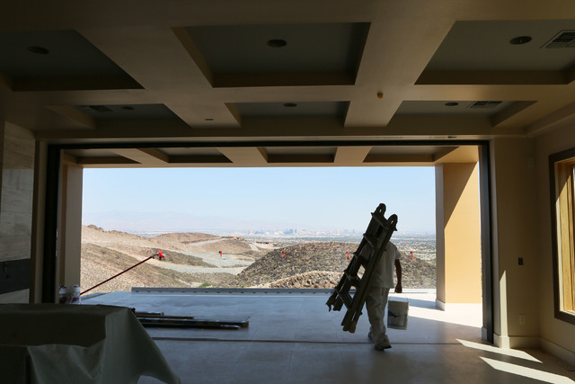 Construction takes place on a 12,000-square-foot custom-built luxury home located in MacDonald Highlands exclusive gated golf course community Tuesday, June 2, 2015, in Henderson. (Ronda Churchill ...