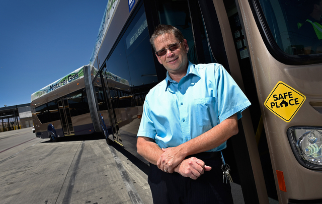 Steve Gebhard, manager of fleet services for the Regional Transportation Commission, stands in the doorway of a natural gas powered bus at a service facility in Las Vegas on Monday, June 22, 2015. ...