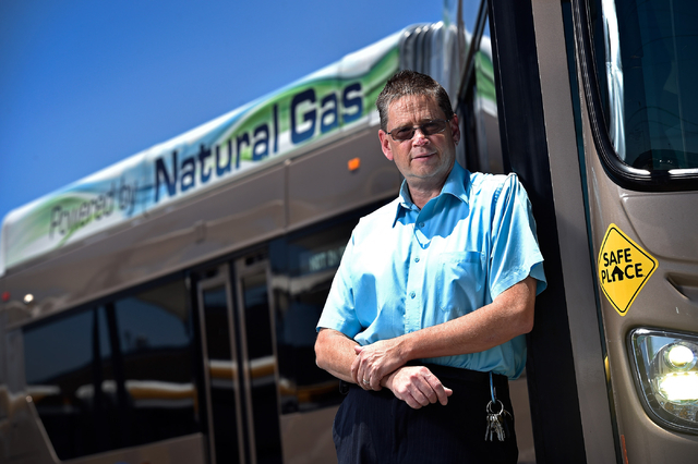 Steve Gebhard, manager of fleet services for the Regional Transportation Commission, stands against a natural gas powered bus at a service facility in Las Vegas on Monday, June 22, 2015. The RTC h ...