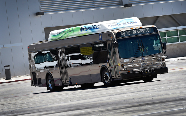 A natural gas powered bus is driven in a Regional Transportation Commission service facility in Las Vegas on Monday, June 22, 2015. The RTC has been replacing its fleet of diesel burning buses wit ...