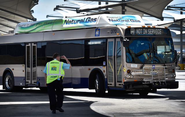 Steve Gebhard, manager of fleet services for the Regional Transportation Commission, greets a driver as he arrives with a natural gas powered bus at a service facility in Las Vegas on Monday, June ...