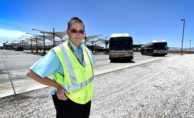 Steve Gebhard, manager of fleet services for the Regional Transportation Commission, stands by two of of the RTC's natural gas powered buses at a service facility in Las Vegas on Monday, June 22,  ...