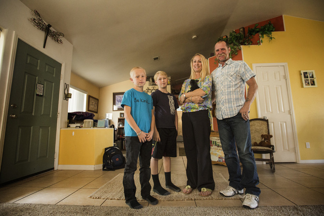 Shawn Taylor, right, with his family Dalton, 11, left, Benjamin, 9 wife Molly, holding Bella the dog, at their northwest Las Vegas home on Tuesday, March 31, 2015.  Taylor family is a microcosm of ...