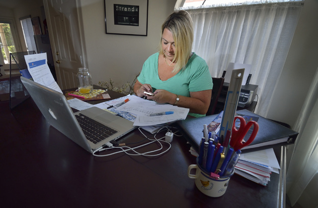 Stephanie Grgas, owner of G & G Marketing Group, is shown at work in her home in Henderson on Friday, June 5, 2015. (Bill Hughes/Las Vegas Review-Journal)