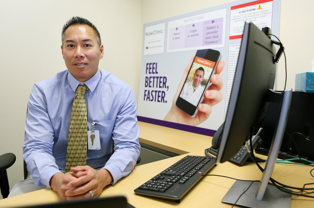 Dr. Eugene Somphone, medical director of Southwest Medical on-demand care, sits in a consult room at Southwest Medical's NowClinic, which allows patients to connect with doctors for a secure, vi ...