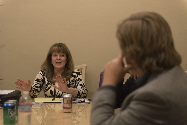 Phronsie Markin, vocalist for the band Alter'd Ego, left, speaks with a reporter at the her residence in Las Vegas Friday, Feb. 19, 2016. The band members work as business professionals at their d ...