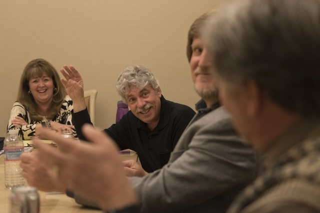 Dave Miller, bassist for the band Alter'd Ego, second from left, speaks with a reporter at the vocalist's residence in Las Vegas Friday, Feb. 19, 2016.  Vocalist Phronsie Markin, left, drummer Lar ...