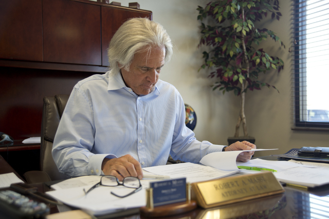 Robert A. Massi reviews paperwork inside his Henderson law offices on Monday, Aug. 15, 2016. His son Robert currently works with the law firm, and son Dominic operates his own insurance business.  ...