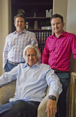 Robert A. Massi poses for a photograph with his two sons, Robert, right, and Dominic inside his Henderson law offices on Monday, Aug. 15, 2016. Robert currently works with the law firm, and Domini ...