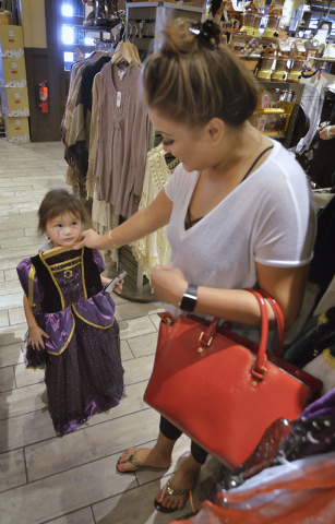 Joanna Lambert, right, checks out a Halloween costume for her daughter Kenley Jade in the store at Cracker Barrel at 8350 Dean Martin Drive in Las Vegas on Friday, Aug. 5, 2016. Bill Hughes/Las Ve ...