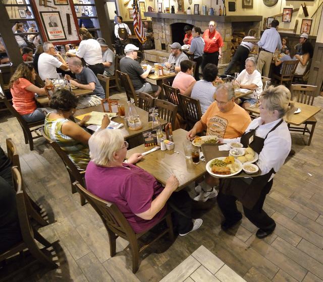 Rachel Rankins, right, serves customers at Cracker Barrel at 8350 Dean Martin Drive in Las Vegas on Friday, Aug. 5, 2016. Bill Hughes/Las Vegas Review-Journal