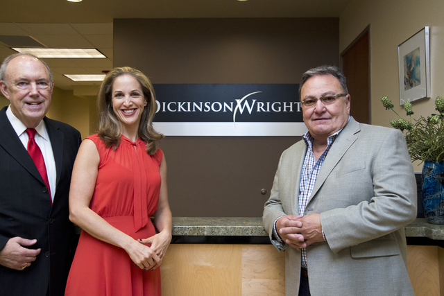 Attorneys Jeff Silver and Kate Lowenhar, left, pose for a photo with Vic Salerno at the Dickinson Wright law offices in Las Vegas on Friday, June 24, 2016. Daniel Clark/Las Vegas Review-Journal Fo ...
