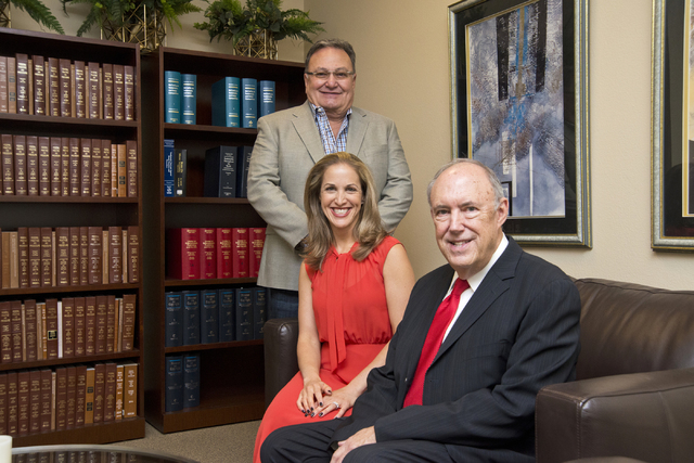 Attorneys Jeff Silver and Kate Lowenhar, seated, pose for a photo with Vic Salerno at the Dickinson Wright law offices in Las Vegas on Friday, June 24, 2016. Daniel Clark/Las Vegas Review-Journal  ...