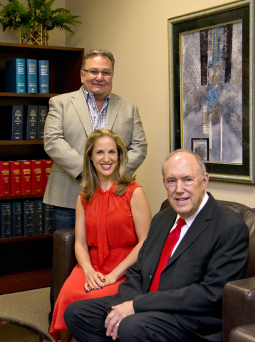 Attorneys Jeff Silver and Kate Lowenhar, left pose for a photo with Vic Salerno at the Dickinson Wright law offices in Las Vegas on Friday, June 24, 2016. Daniel Clark/Las Vegas Review-Journal Fol ...