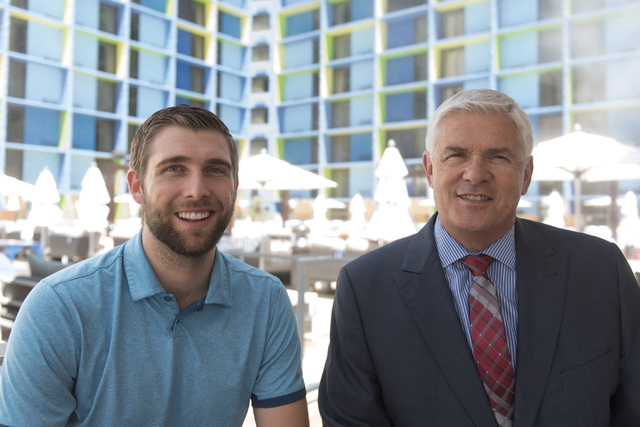 Mark Kelly, vice president of casino operations with Bally's, Paris and Planet Hollywood, right, and his son, Ryan Kelly, pool operations manager at The Linq Hotel, pose at the bar by the pool at  ...
