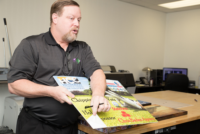 Eric Steadham, FotoZoomer president, explains how digital images are blow up to 44-inch-wide-by-10-foot-long posters, signs or banners. (Tonya Harvey/Las Vegas Business Press)