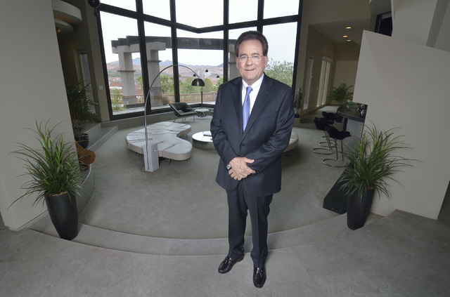 Gene Northup, Las Vegas franchisee for Synergy Sotheby's International Realty, is shown in a client's home at Lake Las Vegas in Henderson on Thursday, Aug. 4. Bill Hughes/Las Vegas Review-Journal