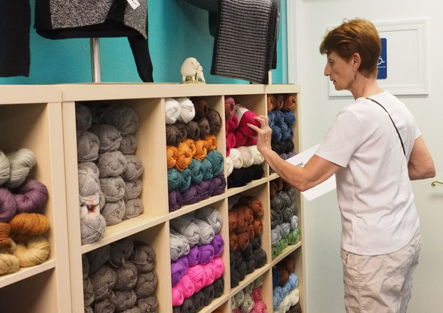 Nancy Dumont, of Las Vegas, searches for yarn at the grand opening of the Mirage Fiber Arts store. (Jerry Henkel/Las Vegas Review-Journal)
