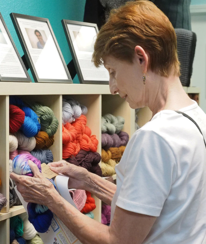 Nancy Dumont, of Las Vegas, looks at a skein of yarn. (Jerry Henkel/Las Vegas Review-Journal)