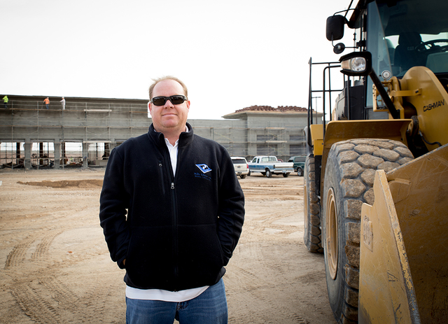 Nathan Schweigart, president of Las Vegas-based NDL Group Inc., a general contracting and consulting firm, stands at Oso Blanca Pavilions, a more than 37,000-square-foot retail project near Farm a ...