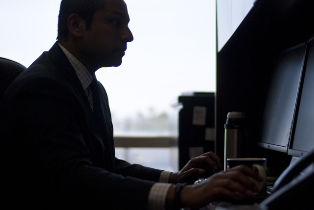 Sharath Chandra, the new administrator of the Real Estate Division of the Department of Business and Industry, uses his computer inside his office in Las Vegas on Thursday, Aug. 25, 2016. Daniel C ...