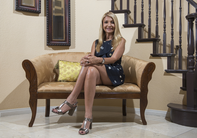 Andreea Porcelli, founder of Monaco Growth Forums International, poses for a photo at her home in Henderson on Wednesday, July 13, 2016. (Martin S. Fuentes/Las Vegas Review-Journal)