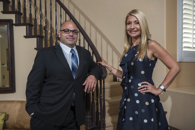 CommunityLeader CEO Joseph Barisonzi, left, and Andreea Porcelli, founder of Monaco Growth Forums International pose for a photo at Porcelli's home in Henderson on Wednesday, July 13, 2016. (Marti ...