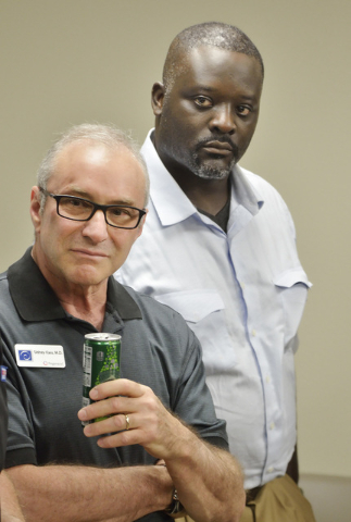 Dr. Sidney Kass, medical director of Regenexx Las Vegas, left, is shown with two-time Super Bowl champion Jarvis Green during a grand opening at the clinic at 100 N. Green Valley Parkway in Hender ...
