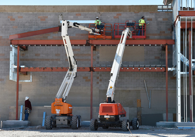 Workers construct the Mountain Edge Marketplace Monday, Oct. 17, 2016, in Las Vegas. The 185,000 square-foot center at the southwest corner of Blue Diamond Road and Buffalo Drive is scheduled to o ...