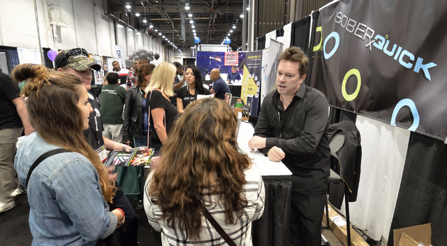 Jared Anderson, president of Liquid Innovations, right, is shown at the SoberQuick booth at the Nightclub and Bar convention and trade show in the Las Vegas Convention Center at 3150 Paradise Road ...