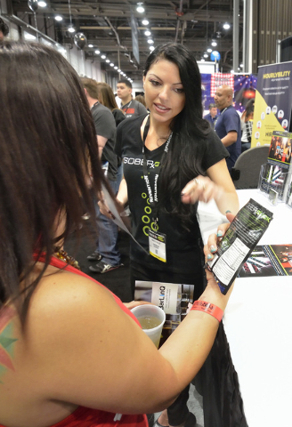 SoberQuick representative Madelyn Feller, right, talks with bartender Carole Lonzanida at the Nightclub and Bar convention and trade show in the Las Vegas Convention Center. SoberQuick, a powder t ...
