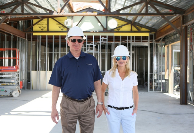 Tivoli Village's Curt Fickeisen, left, general manager, and Heather Fitzgerald, director of brand management, stand for a photo inside the construction of Restoration Hardware Gallery Tuesday, May ...