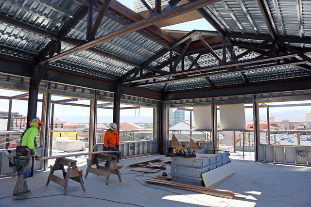 A crew works on construction at Restoration Hardware Gallery Tuesday, May 31, 2016, in Las Vegas. Tivoli Village's second phase is slated to open in October. (Ronda Churchill/Las Vegas Review-Journal)