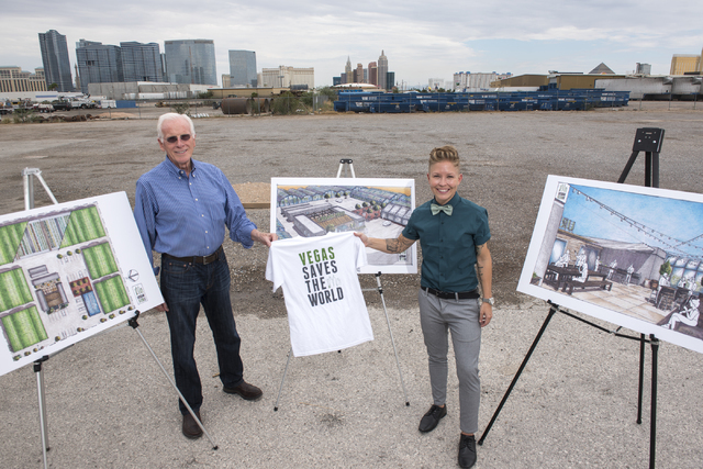 Urban Seed CEO H. Thomas Winn, left, and Vice President/Co-Chairman of the Business Advisory Board Rachel Wenman, poses for a portrait next to renderings of their new compound on 4770 Wynn Road in ...