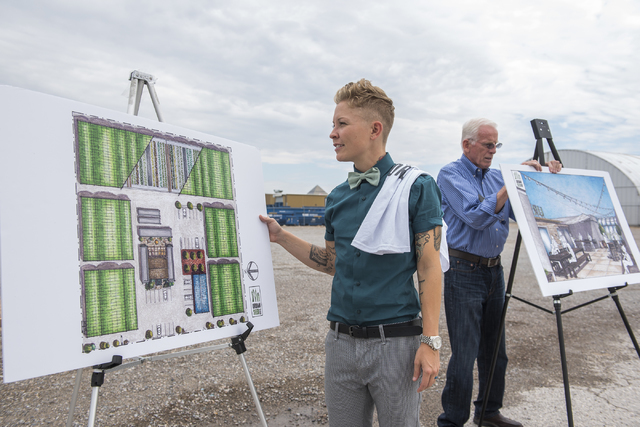 Urban Seed Vice President/Co-Chairman of the Business Advisory Board Rachel Wenman, left, and CEO H. Thomas Winn, is seen standing next to renderings of their new compound on 4770 Wynn Road in Las ...