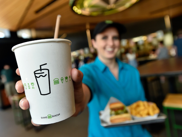 Restaurant manager Michelle Stripp displays a chocolate shake as she holds a Chick'n Shack sandwich with crinkle-cut french fries at the Shake Shack location at the New York-New York hotel-casino  ...