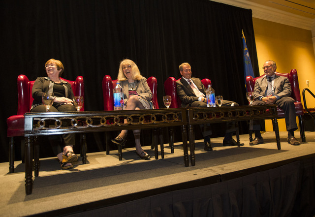 Elaina Blake, from left, Cindy Coletti, Mark Fine and Richard Plaster sit on a panel during a speaking engagement moderated by Norm Clarke during the Southern Nevada Home Builder's җe Built  ...