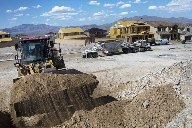 Construction workers clear space for an empty lot in Skye Canyon community May 23, 2016. Experts say the construction industry has added more jobs, but it may not be enough to keep up with future  ...