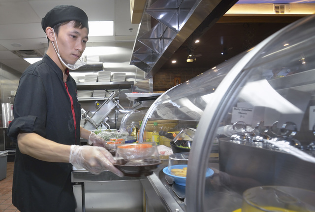 Sashimi chef K.C. Leung loads dishes onto the refrigerated conveyor belt used to take food directly to customers at the Chubby Cattle restaurant at 3400 S. Jones Blvd. in Las Vegas on Thursday, Se ...