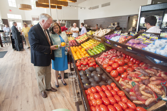 Henderson Planning Commissioner Jerry Mansfield and Henderson City Councilwoman Gerri Schroder mingle on opening day for Seasons Market on Tuesday, June 21, 2016, in MonteLago Village at Lake Las  ...