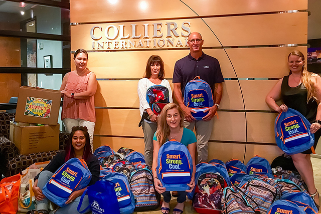 Colliers brokers and employees gathered supplies and donated funds for Tanaka Elementary. (Courtesy)